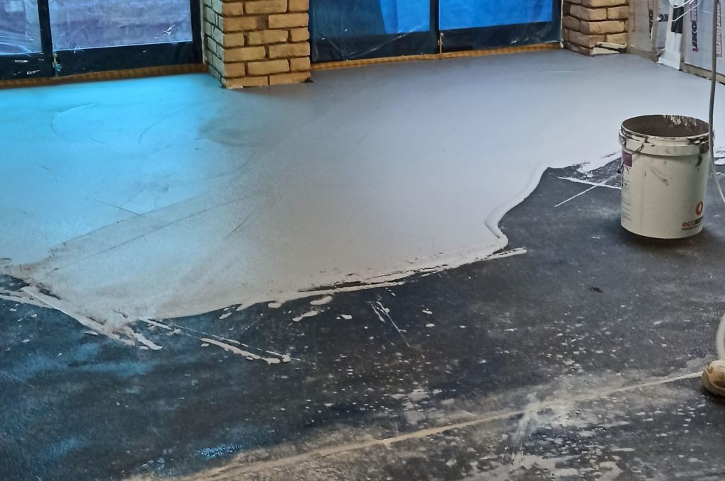Application of first layer of microcement in London basement