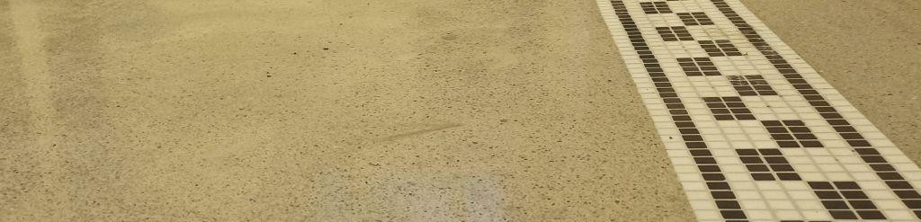 Polished terrazzo floor with marble mosaic inlay